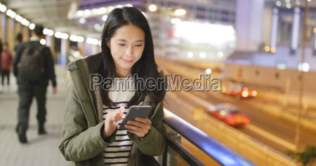 woman look at mobile phone in