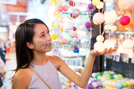 woman shopping in lamp store