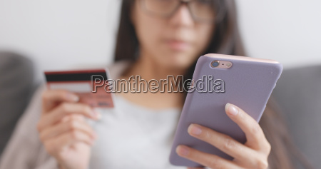 woman shopping online with cellphone and