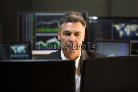 stock market broker looking at multiple