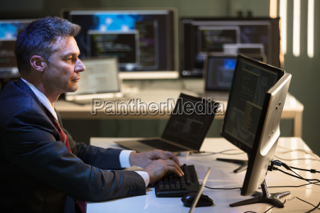 businessman working on multiple computers
