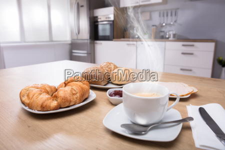 close up of croissants and cup