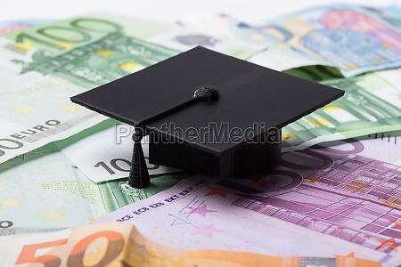 graduation cap on euro banknotes