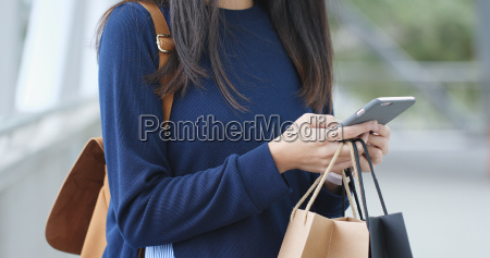 woman use of cellphone and holding