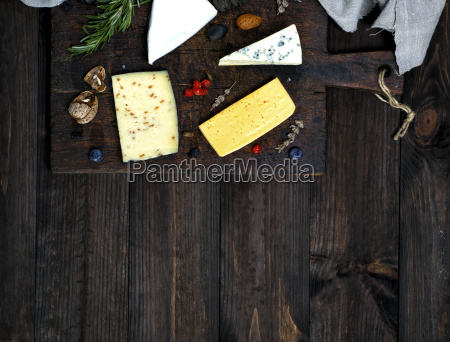 cheese on a brown cutting board