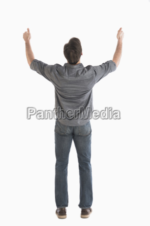 rear view of man raising arms