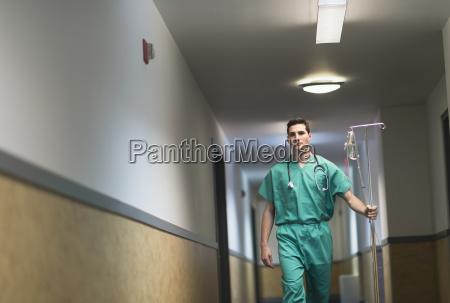 doctor walking in hospital corridor