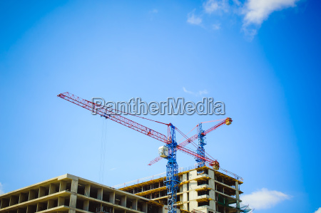 pair of cranes at the construction