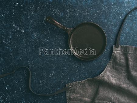 denim cotton apron on dark background