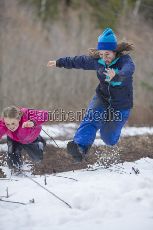 two girls playing in snow sandpoint