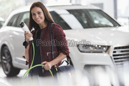 portrait smiling confident woman holding hybrid