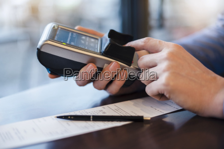 man using credit card reader close