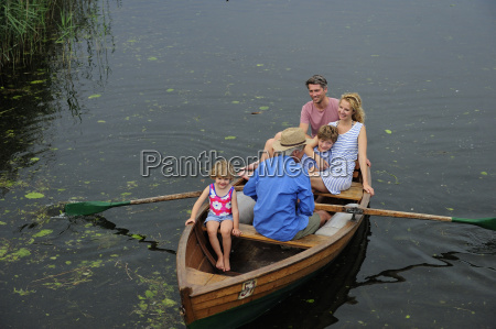 happy family in rowing boat on