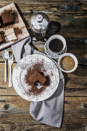 bitten brownie on plate and cup