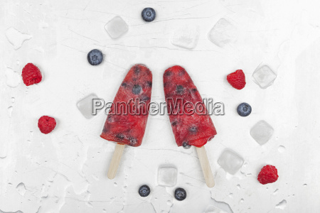 fruit ice lollies with fresh raspberries