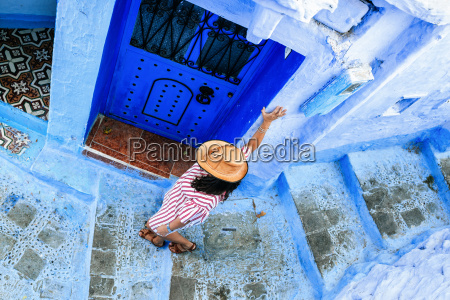 morocco chefchaouen woman walking alley downwards