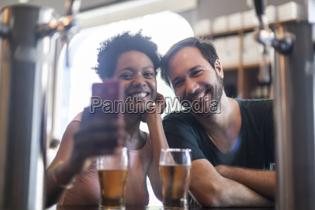 happy couple in a bar taking