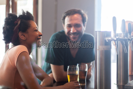 happy couple talking and drinking beer