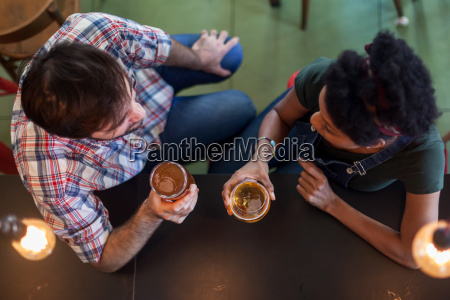 couple talking and drinking beer in