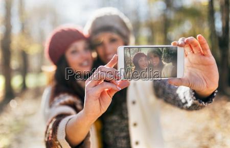 two pretty women taking a selfie