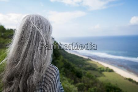 senior woman overlooking ocean