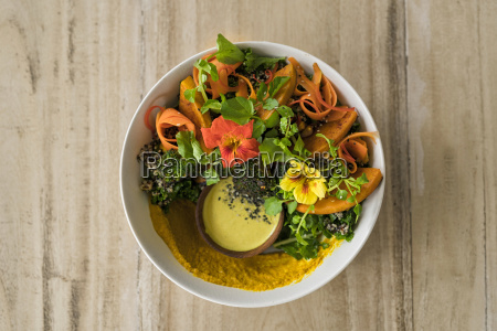 decorated salad with pumpkin hummus broccoli