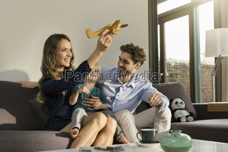 happy parents and son playing with