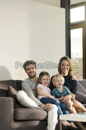portrait of happy family sitting on