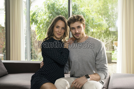 portrait of smiling couple sitting on