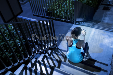 young, woman, sitting, on, stairs, and - 24167104