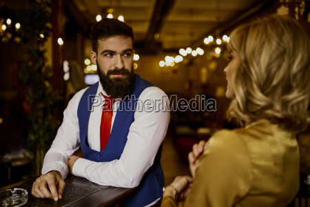 fashionable young man looking at woman
