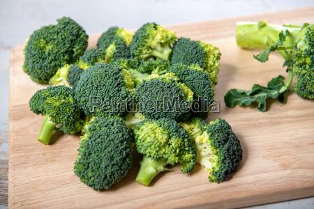 tasty broccoli on wooden board
