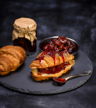 baked croissant with strawberry jam