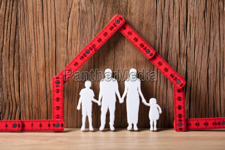 family holding hands under the house