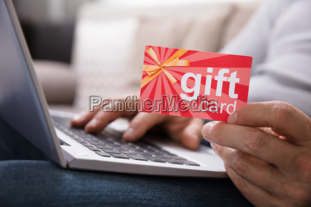 human hand holding gift card