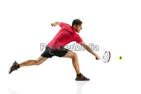 one caucasian man playing tennis player