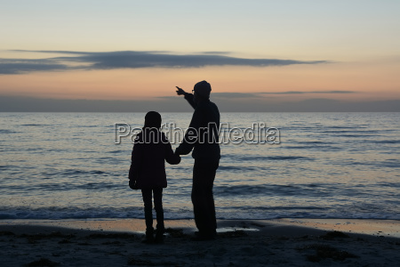 father and daughter at the sea