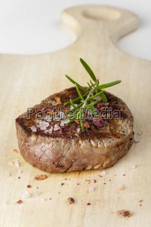 grilled steak with salt on wood