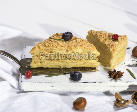 two baked cakes napoleon with cream