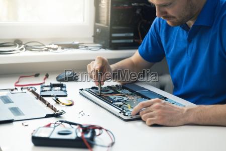 computer repair service technician repairing