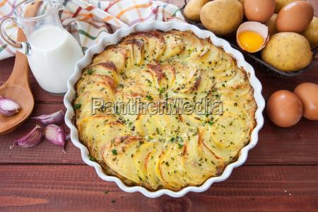 potato gratin in round casserole dish