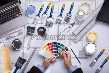 architect holding color guide swatch