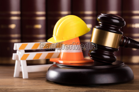 mallet with road barrier hard hat