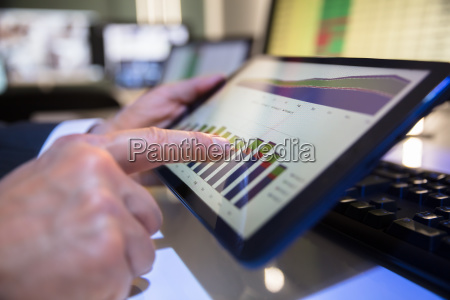 businessperson looking at financial graph on