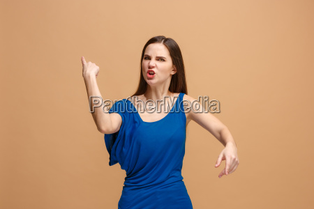 the young emotional angry woman screaming