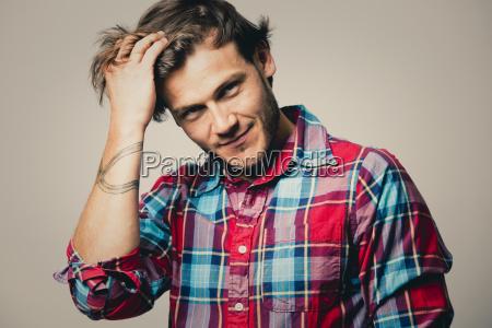 caucasian man wearing checkered shirt and