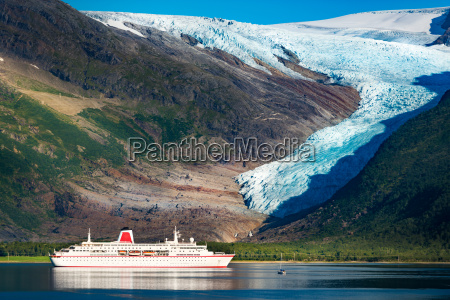 cruise ship at svartisen glacier in