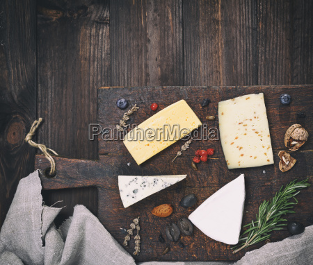 pieces of different cheeses on a