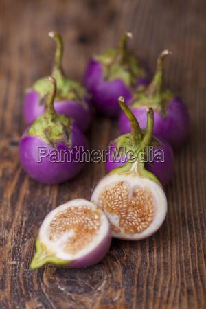 asian eggplants on dark wood