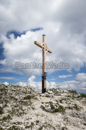 cross on a mountain with clouds